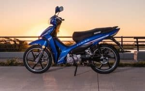 blue moped sunset